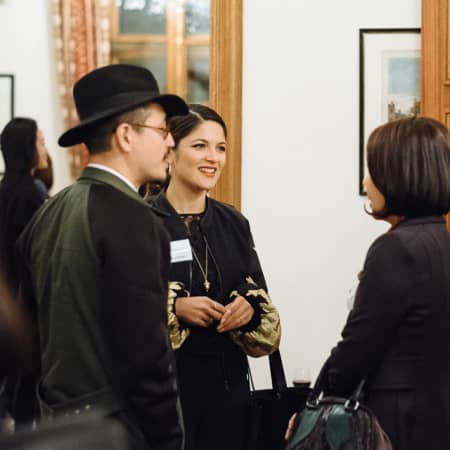 Three guests enjoying the UAL alumni event in Korea