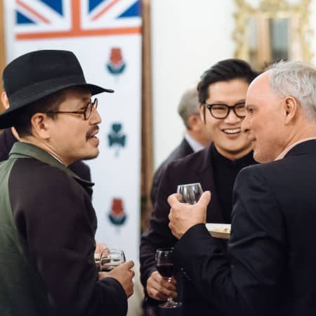 Image of four men in conversation at UAL alumni event in Seoul, Korea