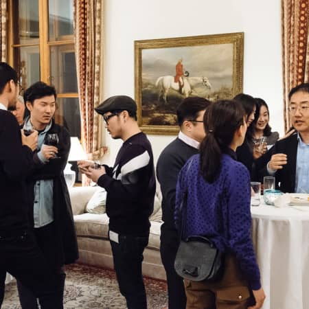 Image of groups of people at UAL alumni event