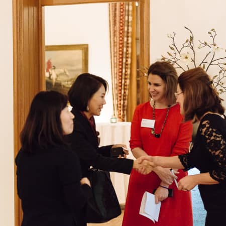 Guests being welcomed by staff at UAL alumni event in Korea