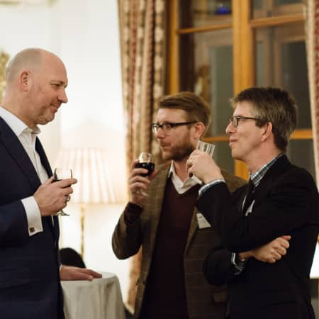 An image of guests in conversation at the UAL alumni event Korea