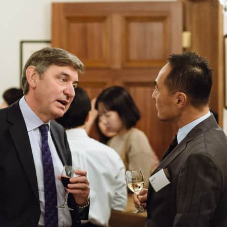 UAL Pro-Vice Chancellor Nigel Carrington talking to guest