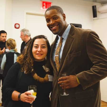 Two guests enjoying the UAL Alumni event in New York
