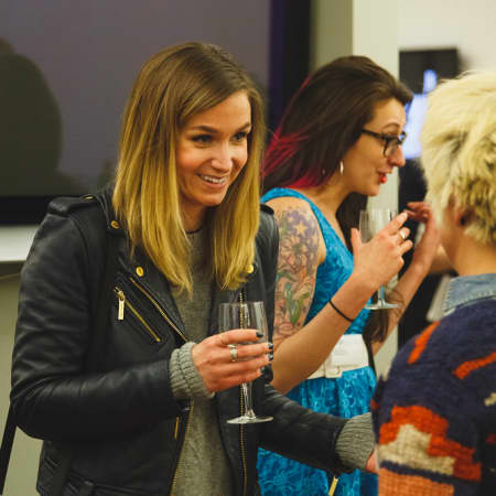 Image of guests mingling at UAL Alumni event New York