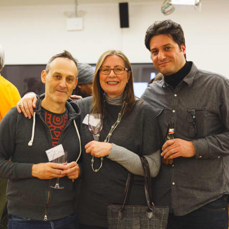 Image of a woman and two men at the UAL alumni event in New York