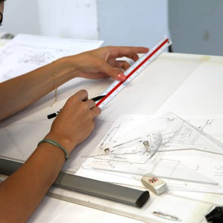 Student working on technical drawing during Architectural Drawing for Designers. Photograph: Spine Photographic.