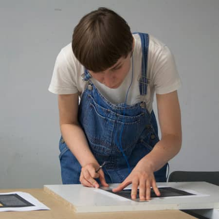Budding Graphic Designer working in the studio during a short course.