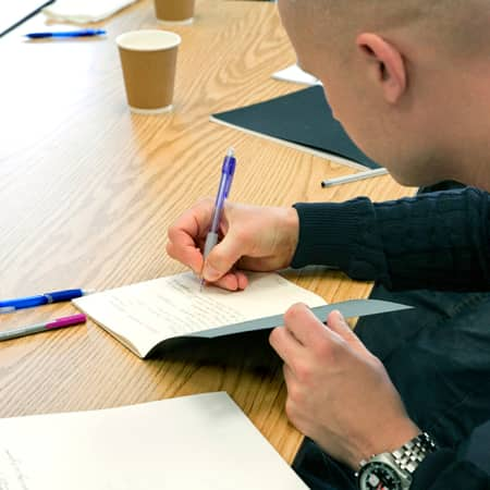Aspiring art director taking notes during a short course. Photograph: Lucy Campbell.
