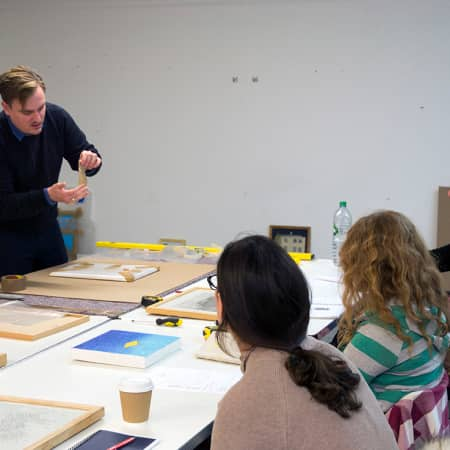 Tutor giving a practical demonstration during a short course. Photograph: Jasmin Woolley-Butler.