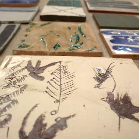 Hand glazed ceramic tiles made by short course students. Photograph courtesy UAL Short Courses.