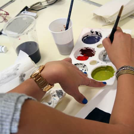 Short course student working with paints during Colour for Interior Design. Photograph courtesy UAL Short Courses.