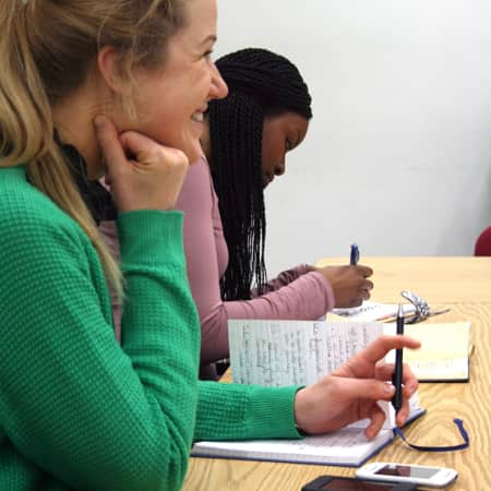 Students listening to tutor during Creative Copywriting. Photograph Lisa Hall.