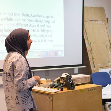 Short course student giving oral presentation in Confidence in Communication. Photograph: Jasmin Woolley-Butler.
