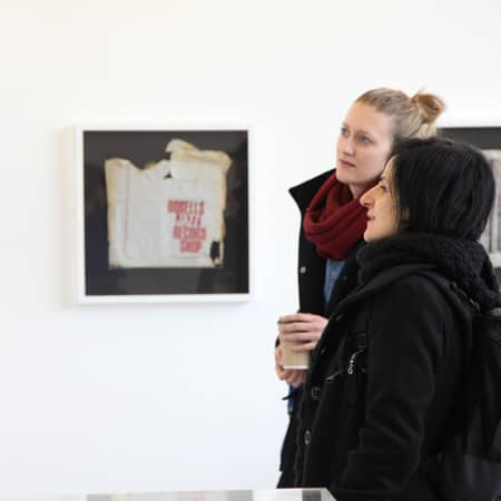 Students looking at artworks during a gallery visit. Photograph: Spine Photographic.