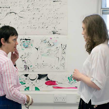 Tutor giving student advise on work during Illustration. Photograph: Jasmin Woolley-Butler.