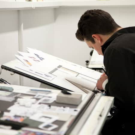 Student working at drafting table during Design for Social Spaces. Photograph: Spine Photographic.