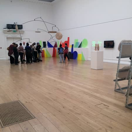 Students listening to a gallery talk during an off site visit. Photograph: Kirsten Cooke.