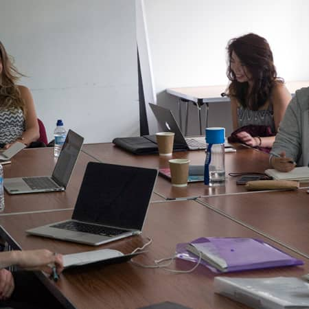 Students discussing writing samples during a short course. Photograph: Jasmin Woolley-Butler.