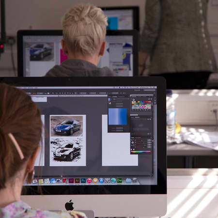 Student laying out magazine on InDesign during a short course. Photograph: Jasmin Woolley-Butler.