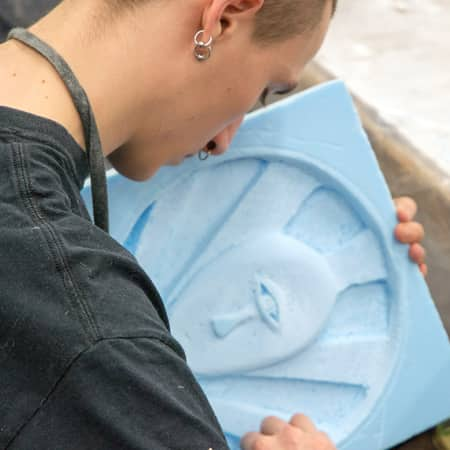 Student carving foam during a Prop Making short course. Photograph: Jasmin Woolley-Butler.