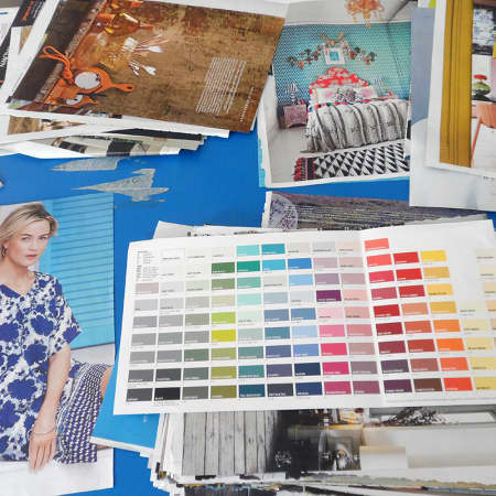 Student creating mood board using magazines and color samples during Renovate and Decorate. Photograph: Sarah Birt.