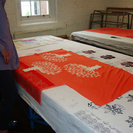 Student working on printed fabric design on Textile Print Design. Photograph courtesy UAL Short Courses.