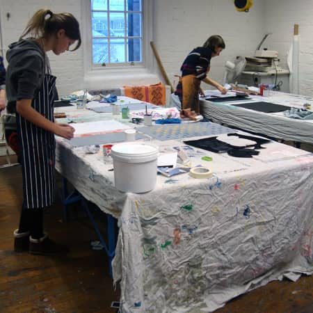 Students hard at work screen printing and stenciling in the textile studio during Textile Print Design. Photograph courtesy UAL Short Courses.