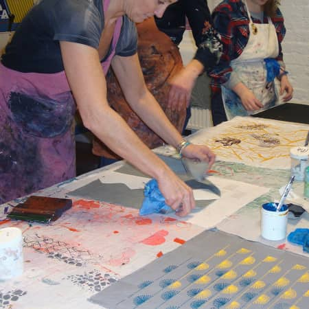 Students experimenting with different patterning techniques on textile short course. Photograph courtesy UAL Short Courses.