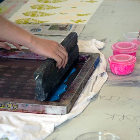Student screen printing during Textiles for Fashion for 14 - 17 Year Olds. Photograph: Jasmin Woolley-Butler.