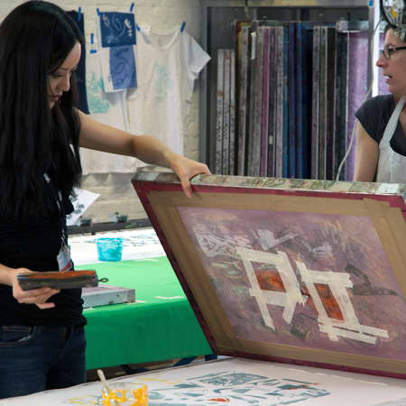 Student creating a screen print on Fabric during a short course. Photograph: Jasmin Woolley-Butler.