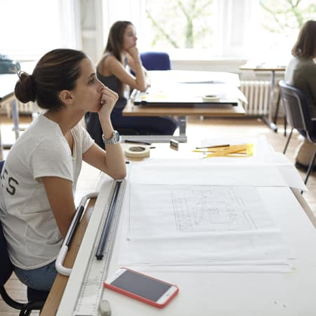 Students listening to a demonstration during an interior design drawing course. Photograph courtesy UAL Short Courses.