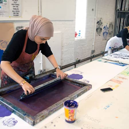 Students screen printing custom design onto Wallpaper during a short course. Photograph: Faye McNulty.