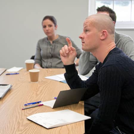 Students in discussion during Creative Copywriting short course.