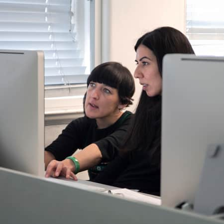 student consulting with a tutor during a Web design Short Course.