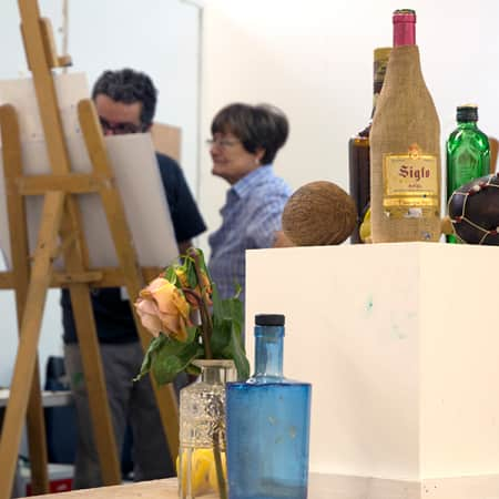 Student in conversation with a short course tutor during Oil Painting