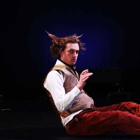 Man sat on stage, Midsummer Night's Dream performance, MA Acting, CSM, 2012.