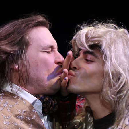 Two men on stage fake kissing, Midsummer Night's Dream performance, MA Acting, CSM, 2012.