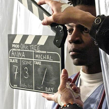 Person holding a clapper board, MA Screen: Acting, CSM, 2012.