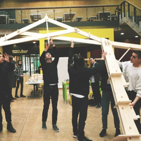 BA Architecture students raising their CNC cut structure.