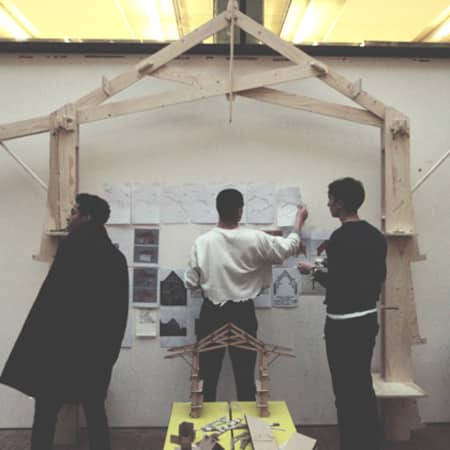 Architecture students set up their work for a final review in the street.