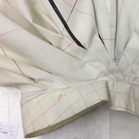 a pleated piece of white patterned fabric