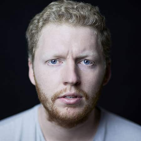 Portrait photograph of Rory Sayers