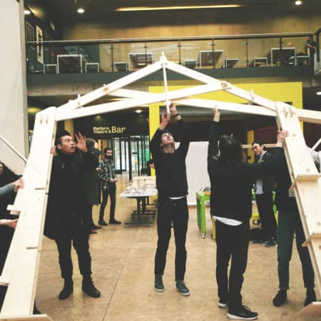 BA Architecture students raising their CNC cut structure