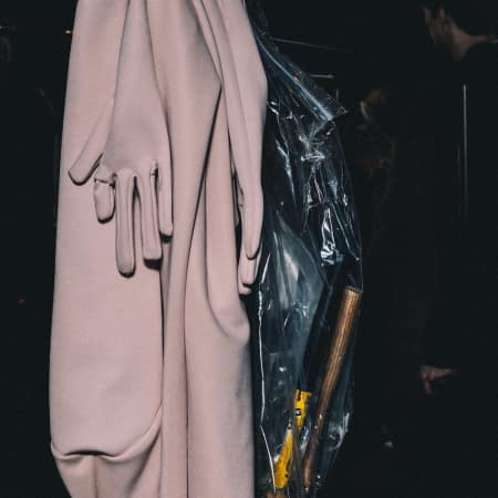 Image of clothes hung on a rail backstage at the MA Fashion Show 2016 - Asia Werbel