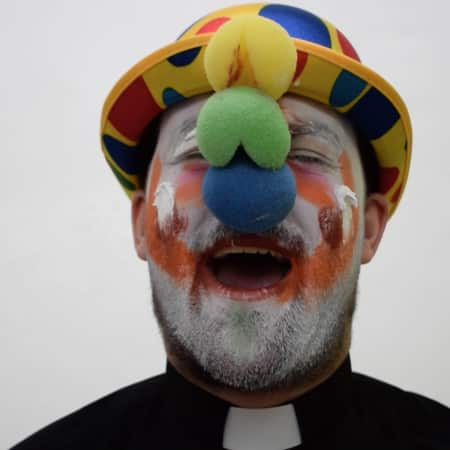 Still image of a clown laughing manically