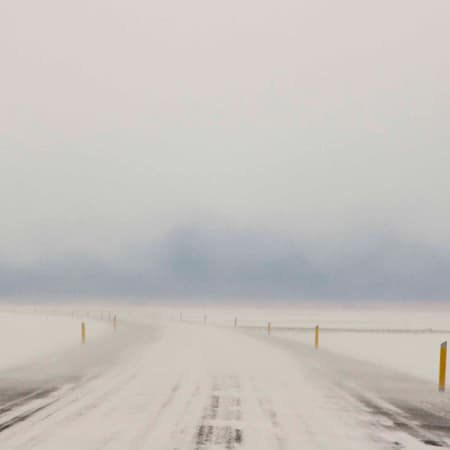 Photograph of a white, misty road.