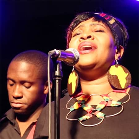 Still from a film by Abbie Stewart showing two singers in The London African Gospel Choir.