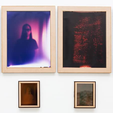 Four framed photographs by Lik Shan Jan Eric Wong