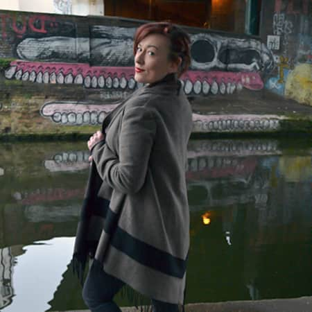 Image of Latisha Berker-Boyd on the canal in front of grafitti.