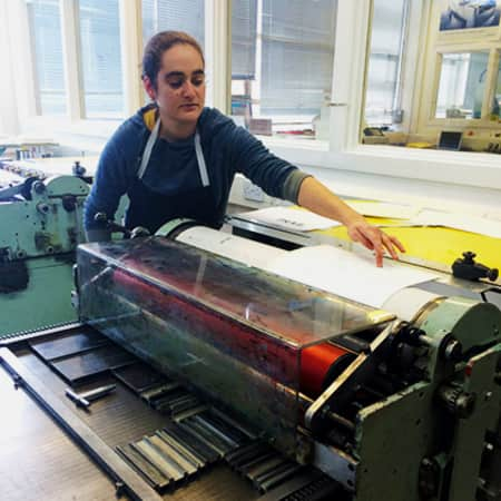 Image of Yael Tur Shalom using a letterpress in LCC.